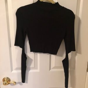 High neck black crop sweater with cut out elbows